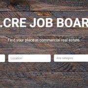 the adventures in cre job board with search box, wood desktop background, and title